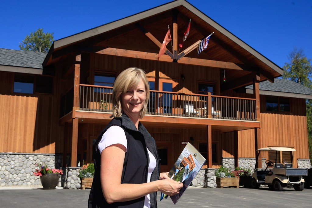 Alpine Meadows Resort receptionist in front of the administrative building